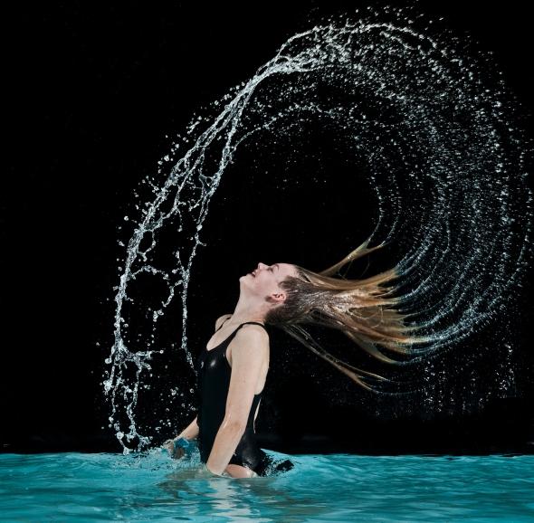 Girl flicking hair in swimming pool