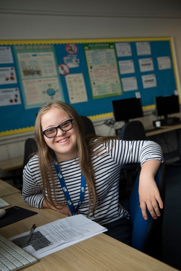 Teenage girl with Down syndrome at college