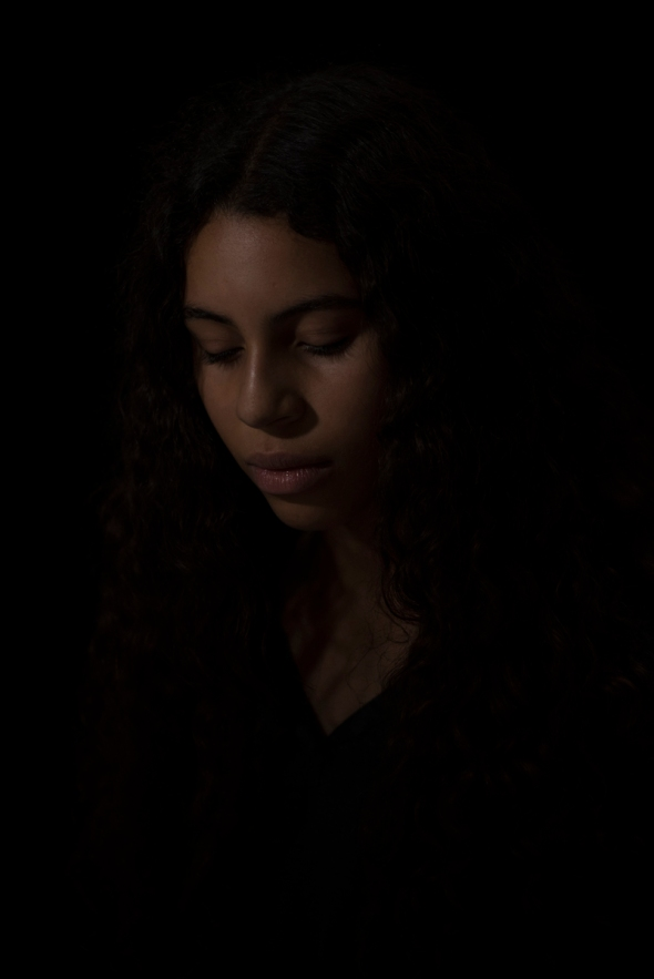 Studio portrait of mixed race teenage girl.
